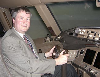 Your writer, at the controls of a British Airways 777-200 simulator.  I landed it safely at SFO....