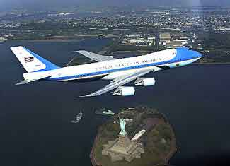 Air Force One flies over the Statue of Liberty.